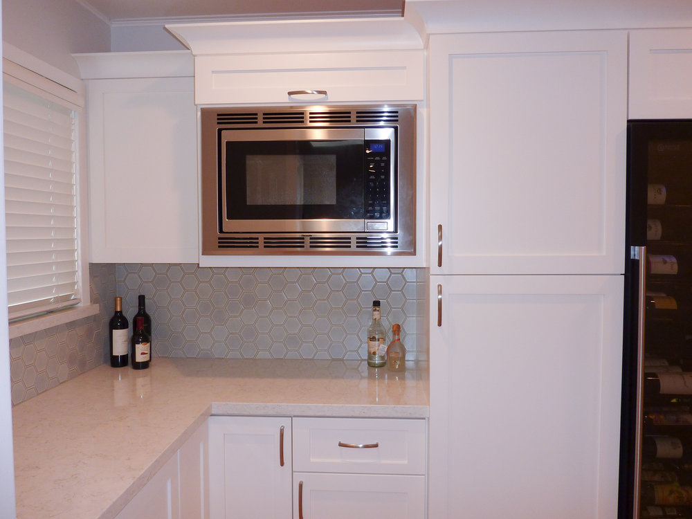 A closer look at the built-in microwave in the walk-in pantry.