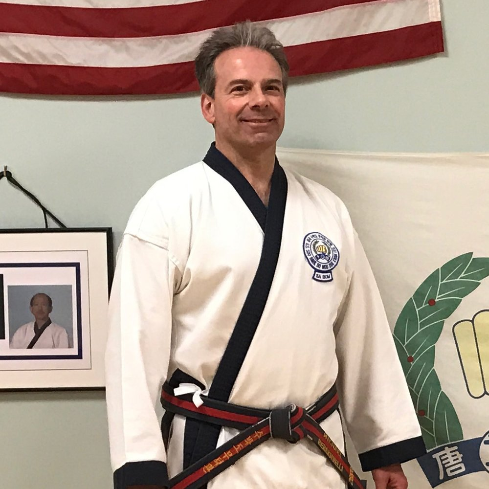Sa Bom Nim Berardinelli   Master Berardinelli is a 6th Degree Black Belt in the Moo Duk Kwan and has over 35 years of experience in the martial arts