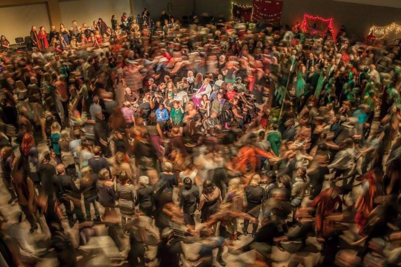 The Spiral Dance is a whirlwind of motion surrounding a select few who remain seated in the middle of it. (Photo:  Michael Rauner and Richard Man )