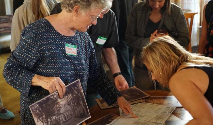 Cohen-Bray family member, Nancy Donald, shows Beatrice historic photos of the house. ( JS )