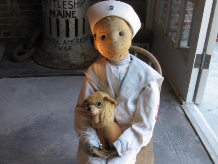 The gift-shop-version of  Robert the Doll  also has those creepy puncture marks on the doll's face.