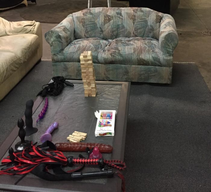 There's nothing better at getting people in the mood than a coffee table piled with sex toys and naughty Jenga. (Photo: A.J. Piell)