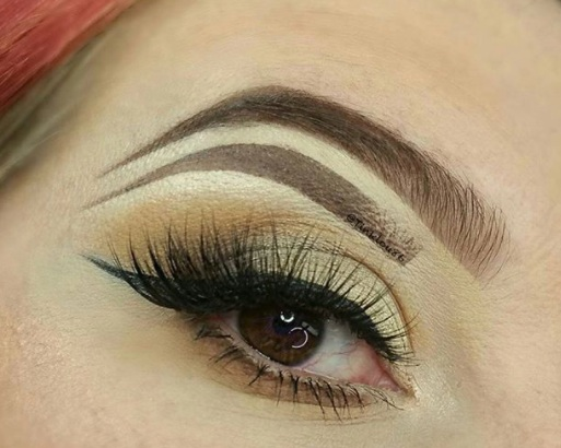 Add mini eyebrows under your arches like British makeup artist  Tink  and prepare for stares.