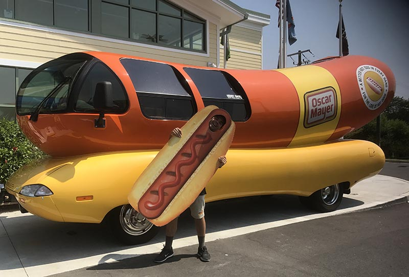 Ricci posing in front of the Wienermobile that was his home-away-from-home for a year. ( Dominic Ricci )