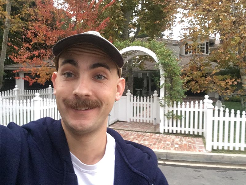Papagan poses for a selfie in front of  RHOBH  castmember Kyle Richards' Beverly Hills home. (  Adam Papagan  )