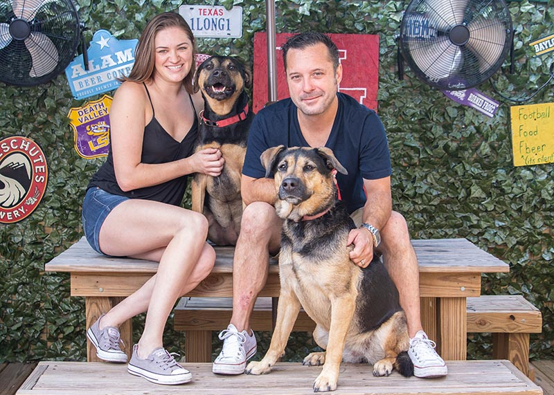 Megan and Steve Long, the creators of Good Boy Dog Beer, and the pups that inspired their drink.   (Good Boy Dog Beer)