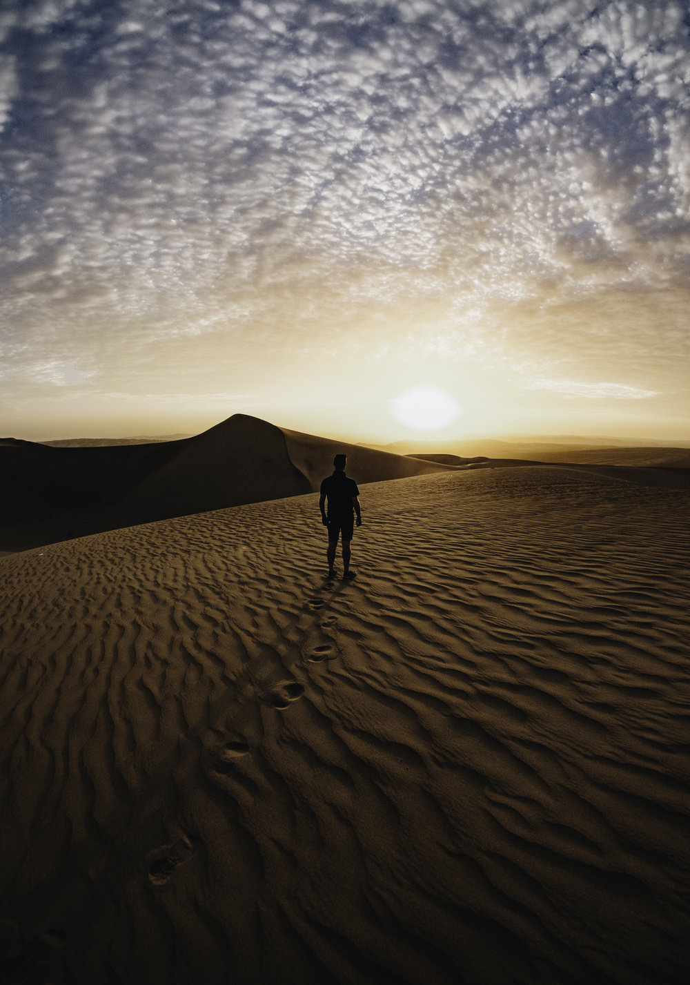 Sunset in the Huacachina desert dunes.