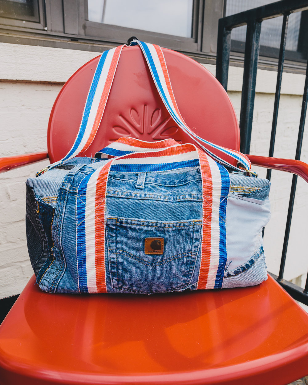 USA Denim Duffel - Made from vintage pants such as Carhartt work jeans, with red, white, and blue webbing.