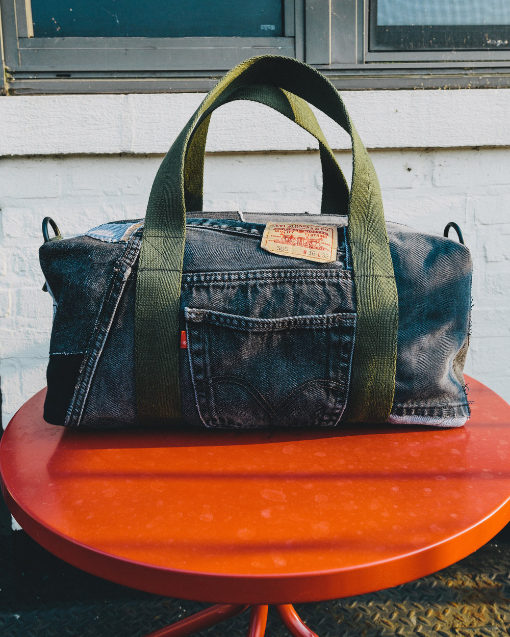 Black/Military Duffel - Made from various dark denims highlighting an American classic; the Levi's jean.