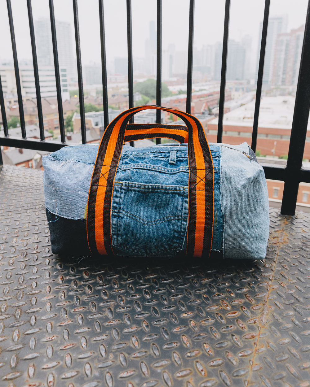 Overnight Patchwork Duffel - The very first bag I made; this was done reusing vintage denim as well as deadstock vintage hardware and straps