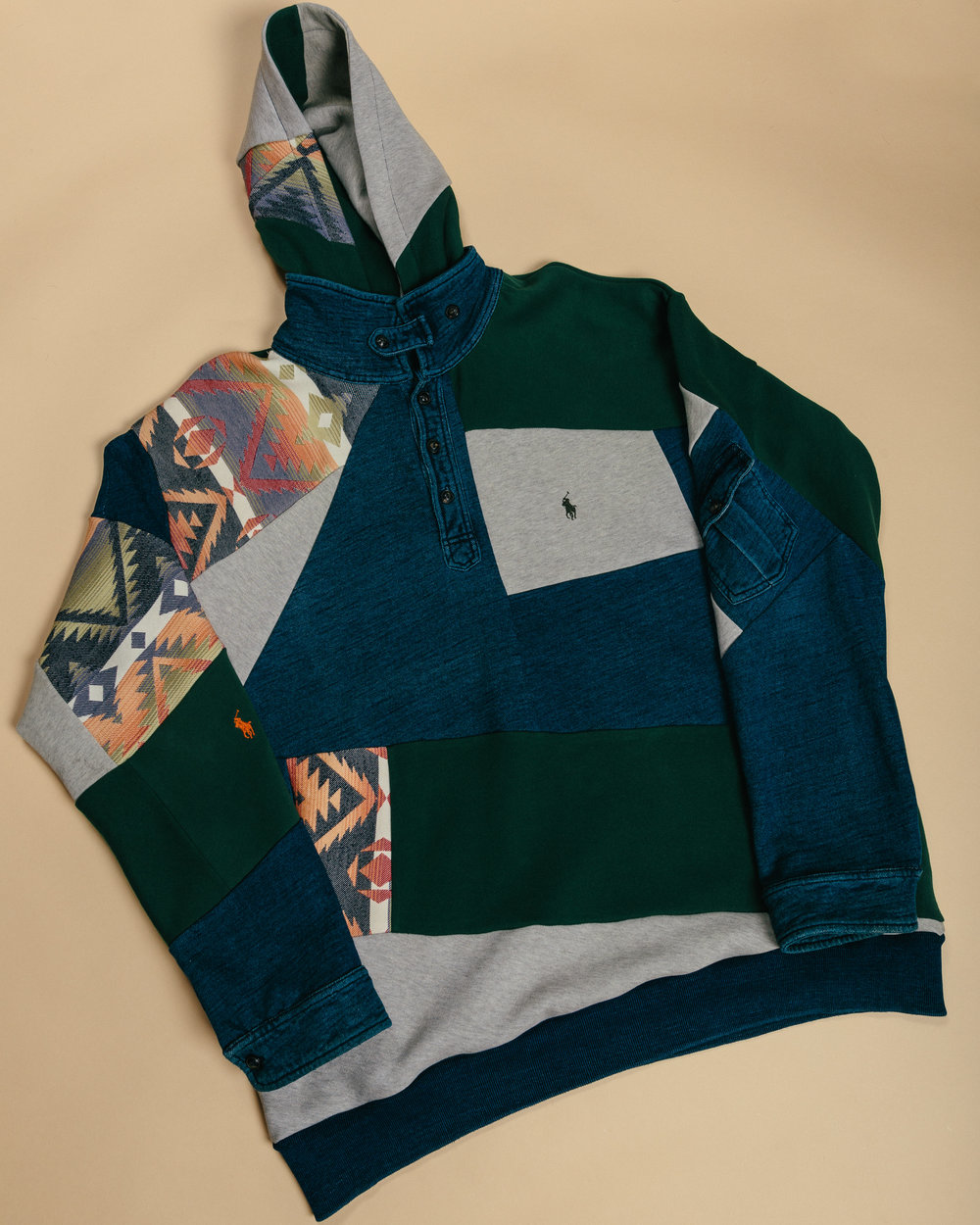 Ralph Lauren Sweater-Hoodie - Made from 3 ralph pieces with a fully button down neck along with side pocket on the left arm and side pockets.