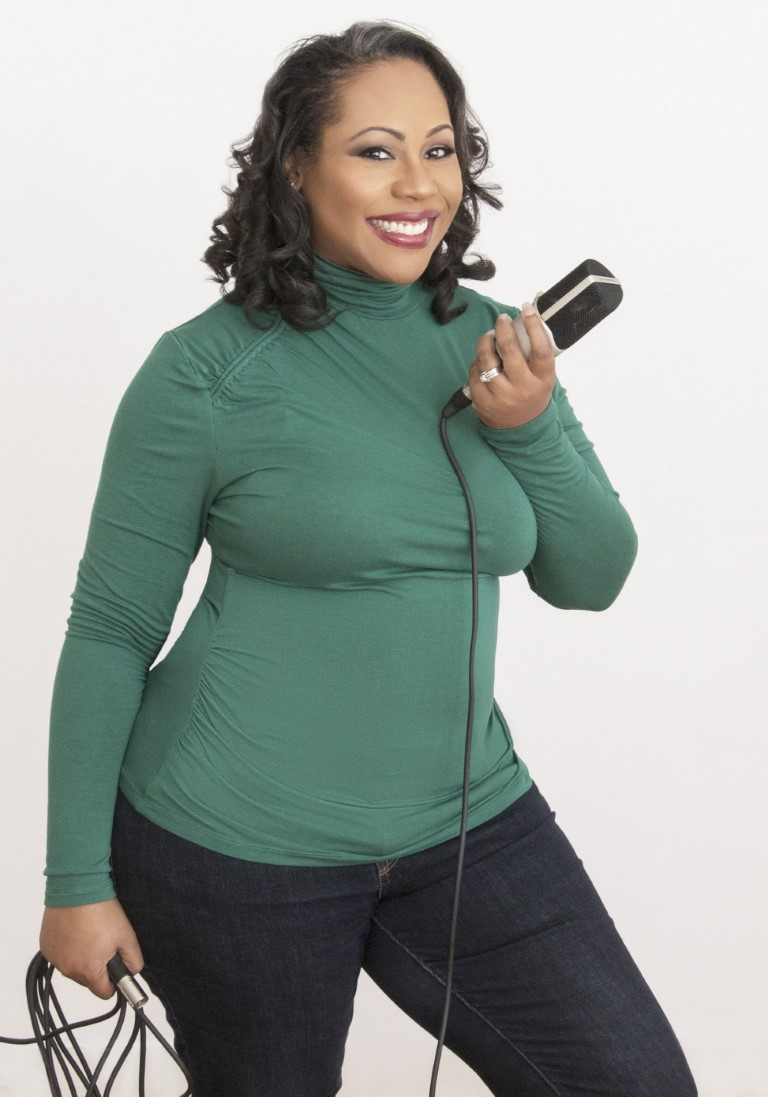 Daree Allen, black female voice over artist, holding the mic