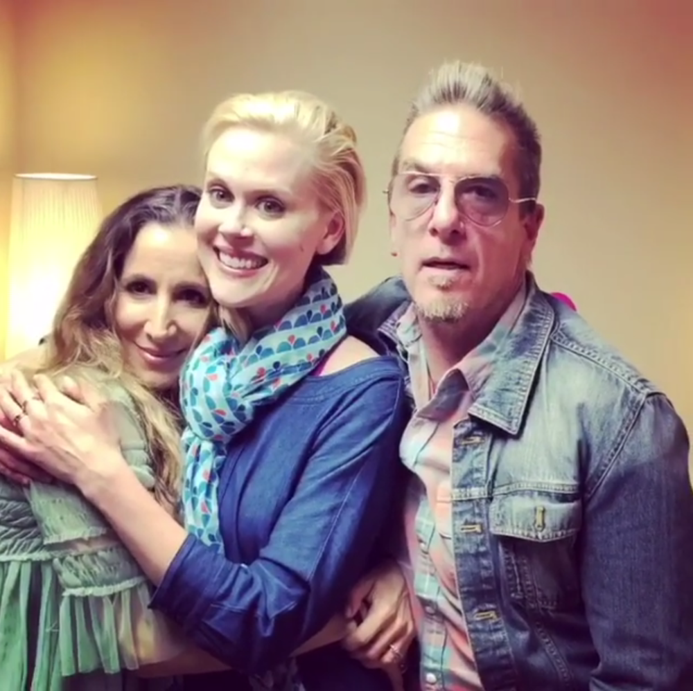 """Maybe It's You with Greg & AmiiraJanet Varney – The Allowance of Self(May 1st, 2018) - Amiira and Greg are joined by the star of Stan Against Evil, Janet Varney, to chat about reaching next level comprehension and awareness in your relationship, the personal behavior revelations from watching the Crown, and the """"Pillow Incident""""."""