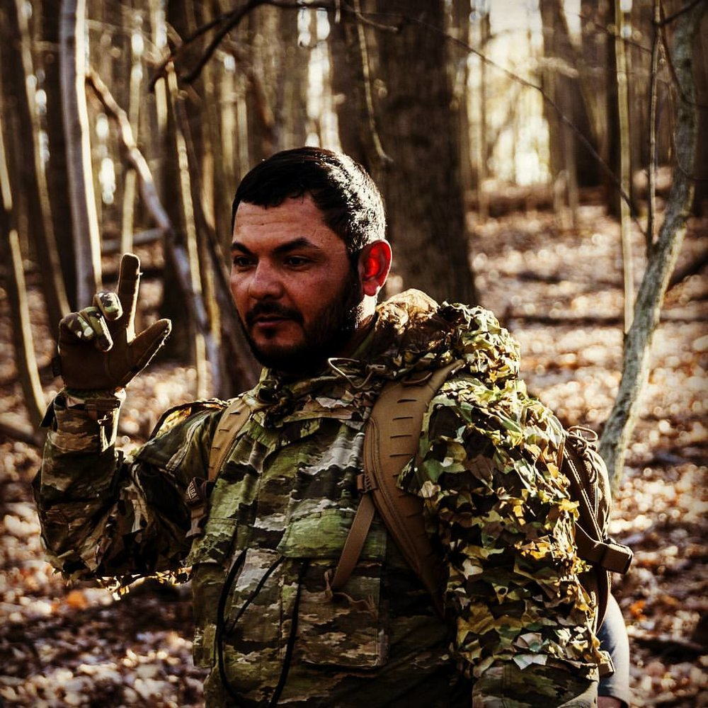 "GREENSIDE TRAINING LLC - Tactical/Combat Tracking Subject Matter Expert, Mr. Freddy Osuna is a trusted authority on the subject of visual tracking and is the published author of ""Index Tracking- Essential Guide to Trailing Man and Beast,"" 2012. He is also a contributing writer to Breach Bang Clear, Recoil Magazine and various other military and law enforcement related publications. His knowledge is based on a foundation of real-world deployments and formal Combat Tracking instructor experience with U.S. and allied militaries, federal, state, and municipal law enforcement entities. Osuna's innovative approach to teaching visual tracking and sensory awareness is turning heads amongst the nation's top hard skills trainers. Osuna harnesses his Native American and Marine Corps culture to deliver holistic, powerful, and scientific based lessons steeped in North American tracker lineage.Osuna has most recently performed as a forensic impressions expert/instructor for the U.S. Army Weapons Intelligence Course Ft. Huachuca, AZ, as the 2nd MARDIV School of Infantry East/Combat Hunter Course, Combat Tracking SME 2013-2014 lead instructor for the U.S. Army Combat Tracker Course at Ft. Huachuca, AZ 2008-2010. His school Greenside Training founded in 2011 provides visual tracking and sensory awareness development training for small units and individuals alike. His unique course offerings include Green Laser Index Night Tracking (GLINT), Index Tracking, Grayside Hunter, and the Battlefield Tactical Acuity Course (BTAC). Fusing ancient Native American field craft with 21st century technology; Greensider Freddy Osuna is making tracks into the future while preserving the old."