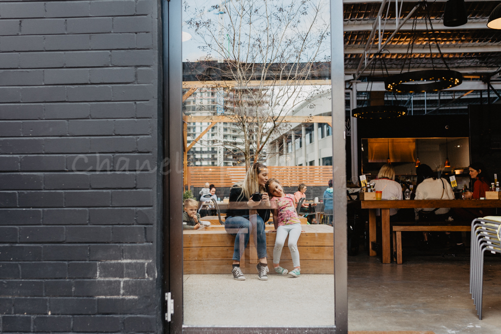 Self Portrait in the window of myself and my daughter at the Perth Mamas Event in August at Blasta Brewing Co by Chanelle Megan Photography