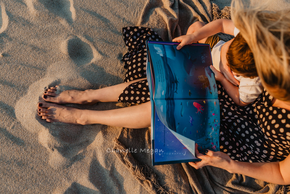 Lifestyle Photographer, captures Mummy and Me reading a book together. Chanelle Megan Photography