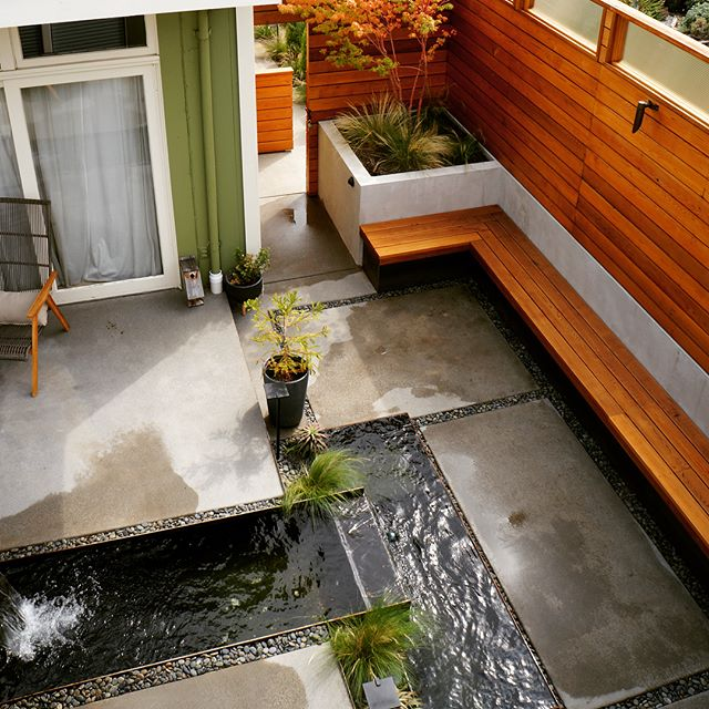 Mid century courtyard remodel. #clearcedar #customsauna #steelwaterfeature