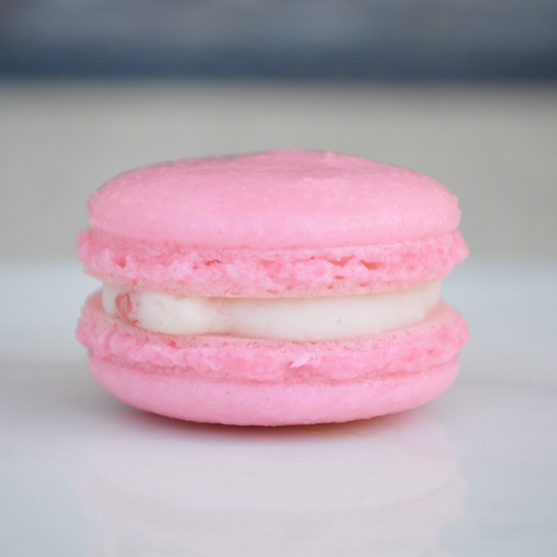 STRAWBERRIES & CREAM: our strawberry macaron filled with a Louisiana strawberry and cream buttercream. This macaron is gluten free.