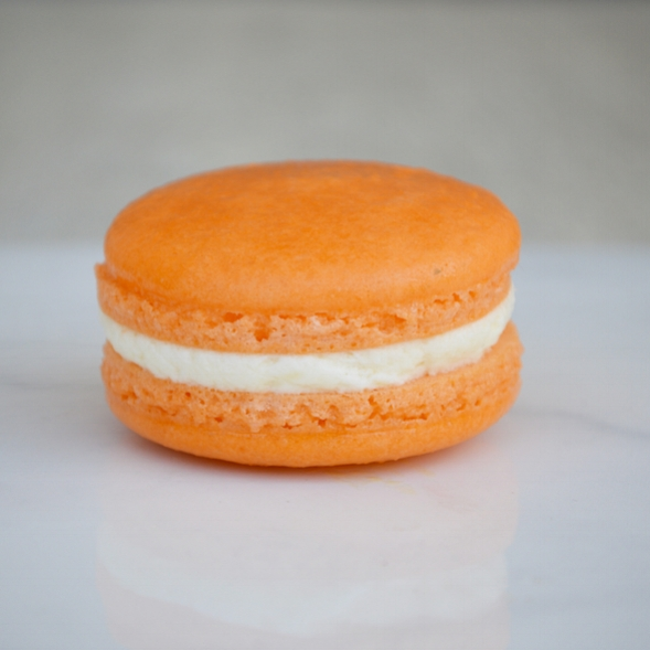 Orange Creamsicle Macaron: Our orange colored macaron filled with a fresh squeezed orange cream. Gluten-free.