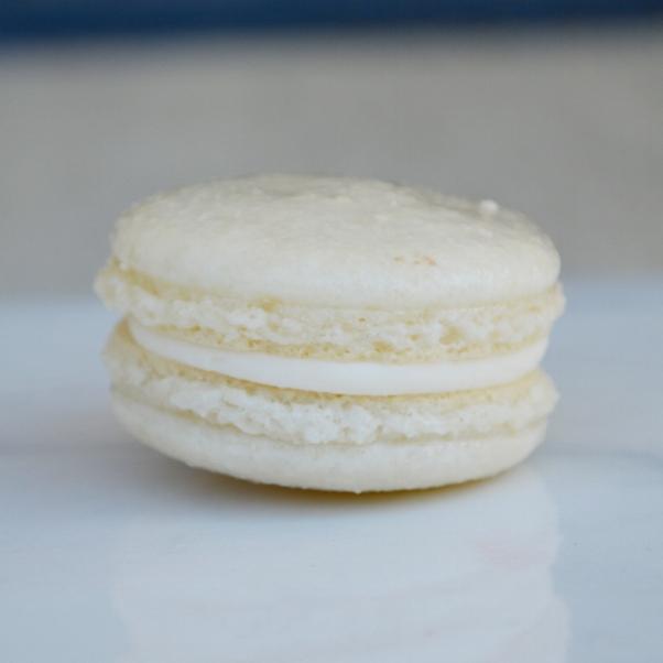 VANILLA-ALMOND MACARON: a vanilla-almond macaron with a vanilla-almond buttercream. This macaron is gluten free.