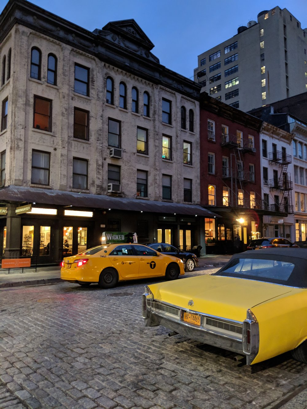 Taxi in Tribeca w a sweet lil Cadi on the sidewalk