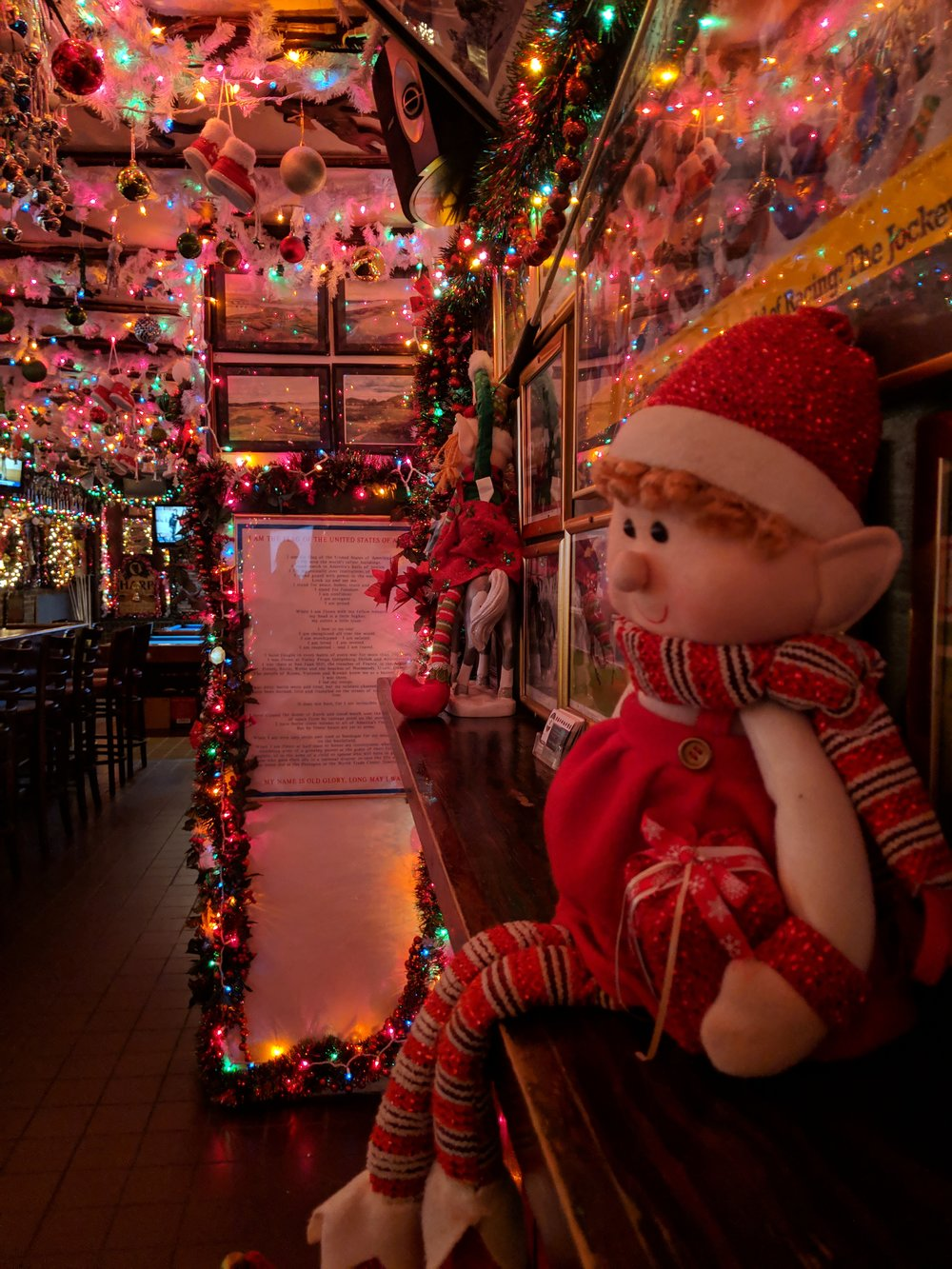 Elf on the bar shelf at   Paddy Maguire's