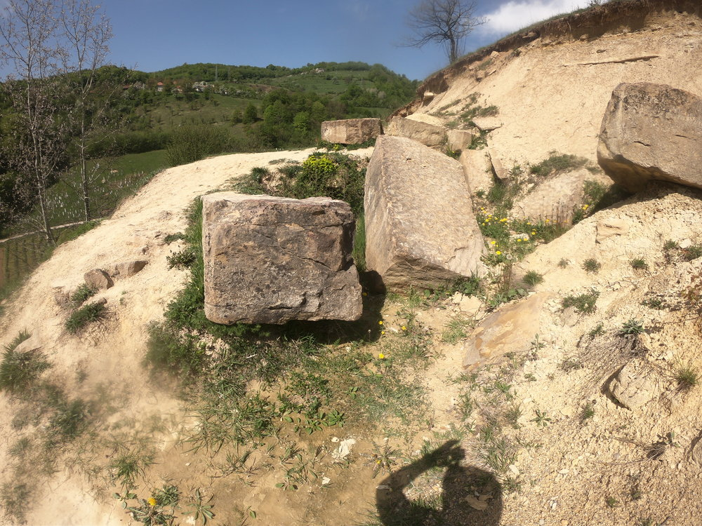 The 'Rock' which form one of he tiers of the Tumulus??  Natural or Manmade?