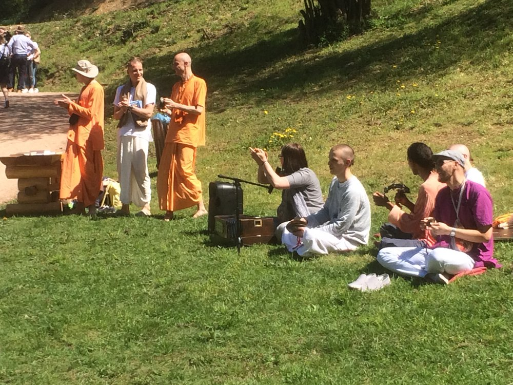 Followers of Hare krishna Making Music and singing in the park