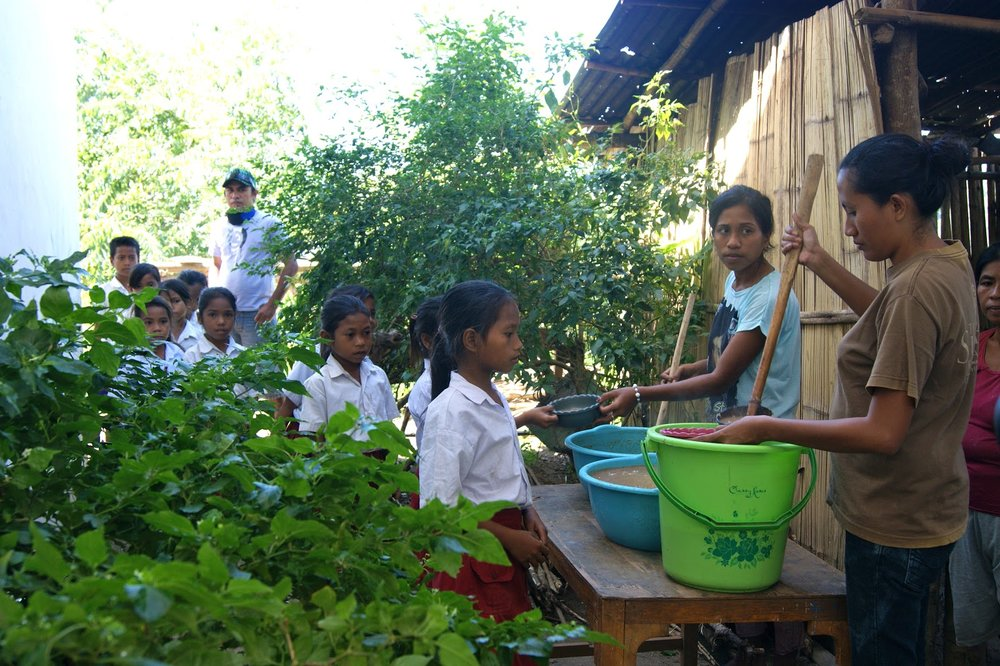 Rainy Octora serving lunch to students as part of one of the Sumba Foundation's project to decrease malnutrition.