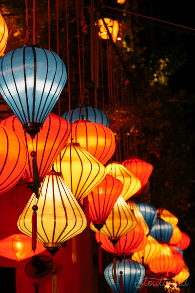 Glowing lanterns light up the dark streets of Hoi An Vietnam.