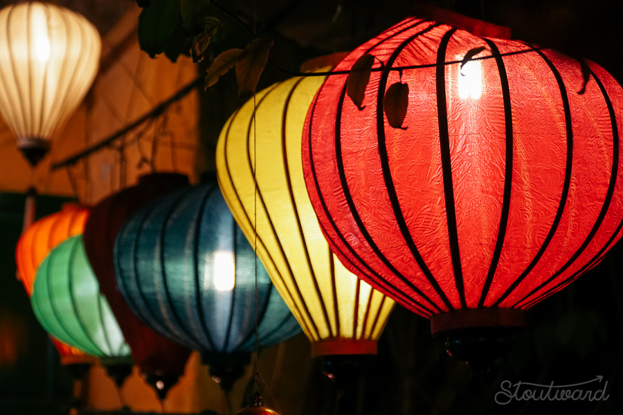 Glowing lanterns light the way at night in Hoi An Vietnam.