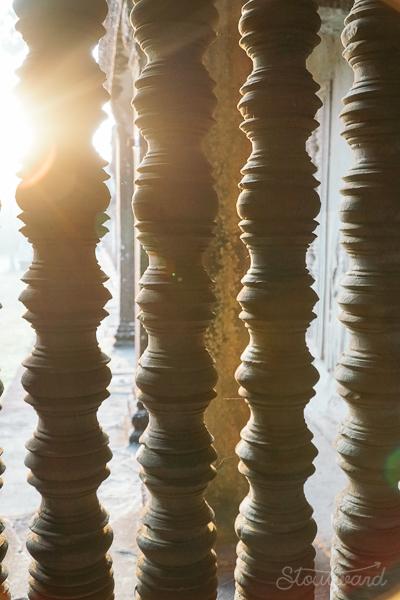 pillars with light shining through in angkor wat siem reap cambodia
