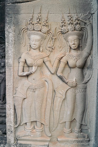 temple carving of two women in the north gate of angkor wat in siem reap cambodia