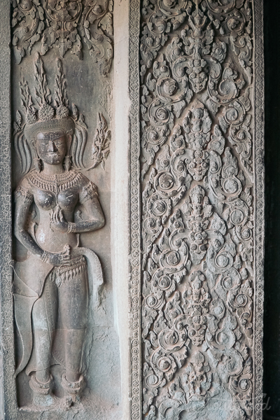 temple carving of woman in the north gate of angkor wat in siem reap cambodia