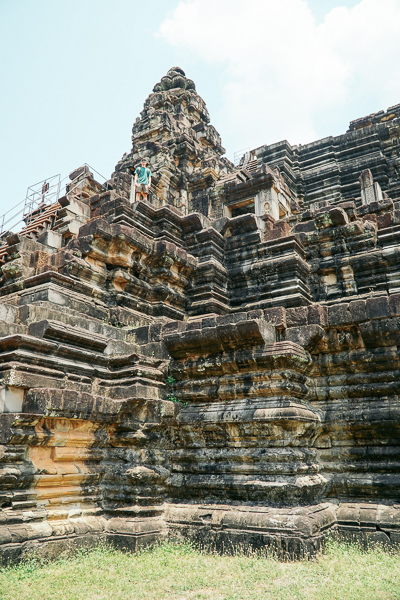 Andrew on top of very steep steps up the side of the Baphuon temple in Angkor Thom outside of Siem Reap, Cambodia.