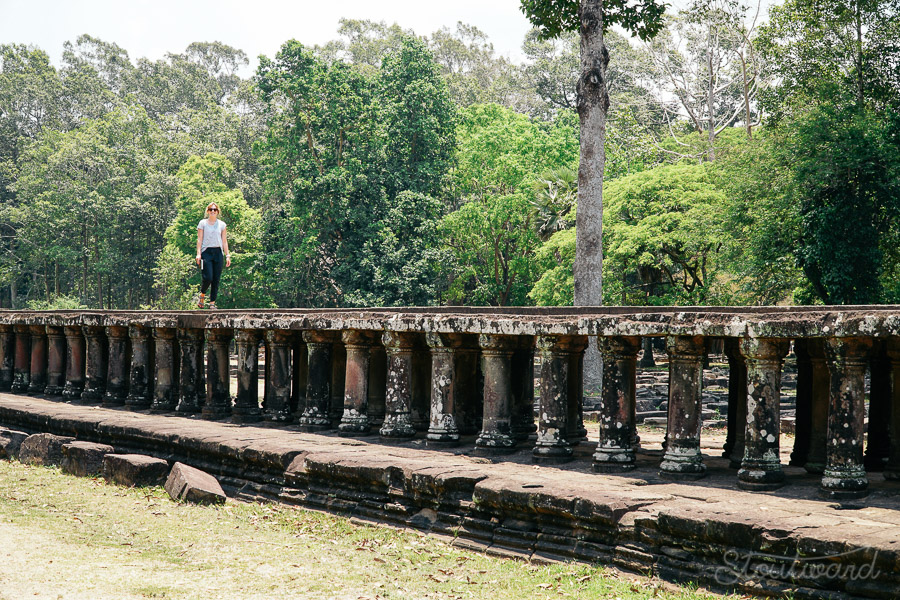 Kelsey on raised walkway ruins by Baphuon temple in Angkor Thom outside of Siem Reap, Cambodia.