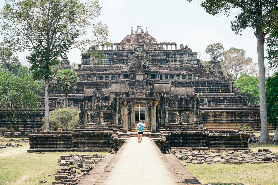 man with blue backpack walking into Baphuon temple in Angkor Thom outside of Siem Reap, Cambodia.