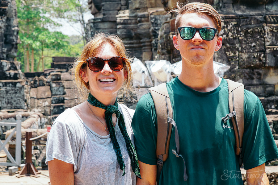 Kelsey and Andrew covered in sweat in Bayon after a long day of temple exploring in the Ankgor area of Siem Reap, Cambodia. Tourist outfits on a hot day in Angkor Wat.