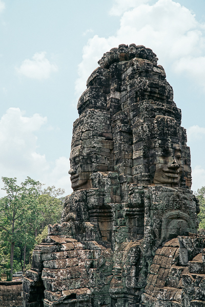 Tower with the four faces of Buddha. One of many inside the Bayon temple inside Angkor Thom in Siem Reap, Cambodia.