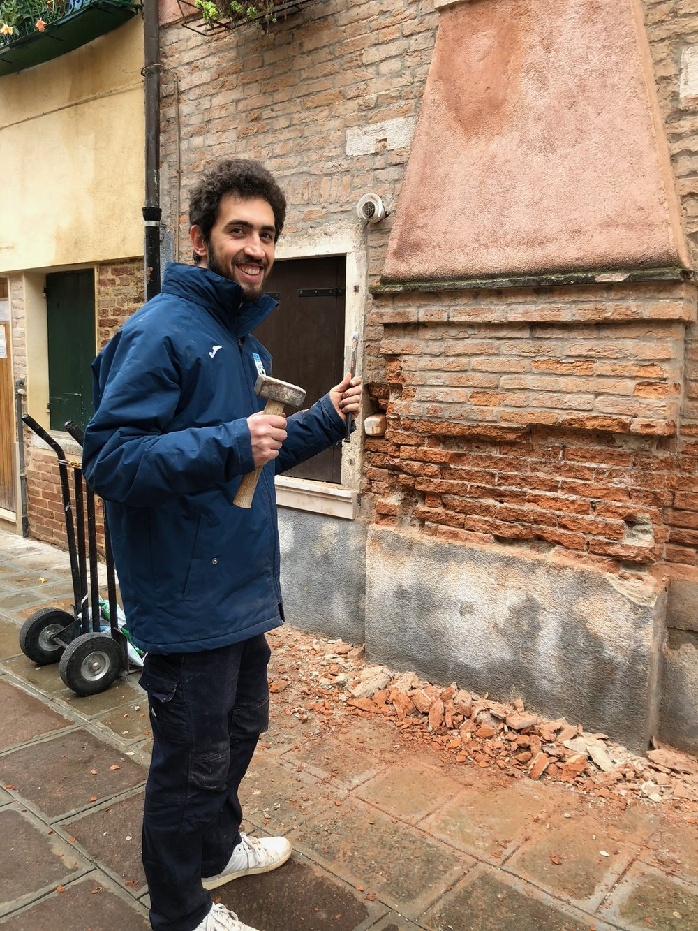 Friendly man refacing brick on Via Marino Secco