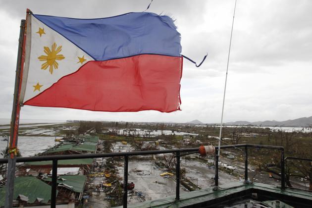 Philippine-Flag-waving-in-Tacloban-Leyte.jpg