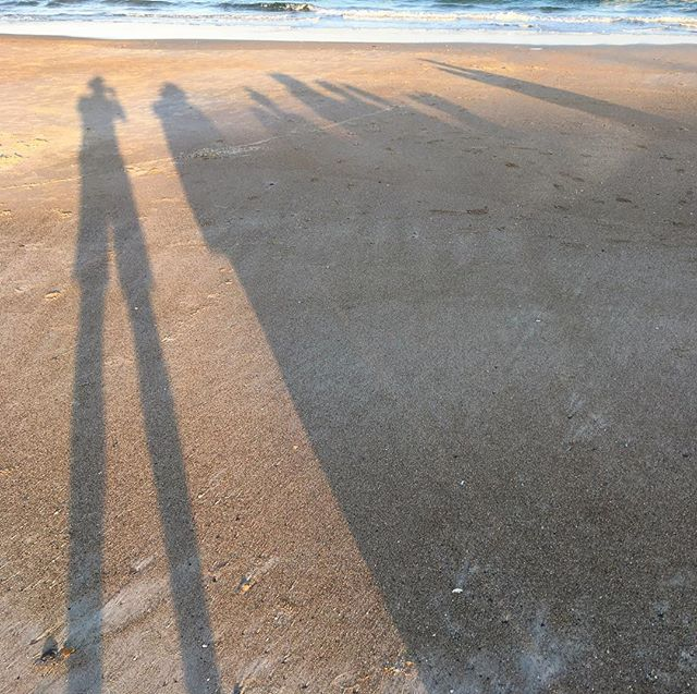 The shadows of my family at the beach.