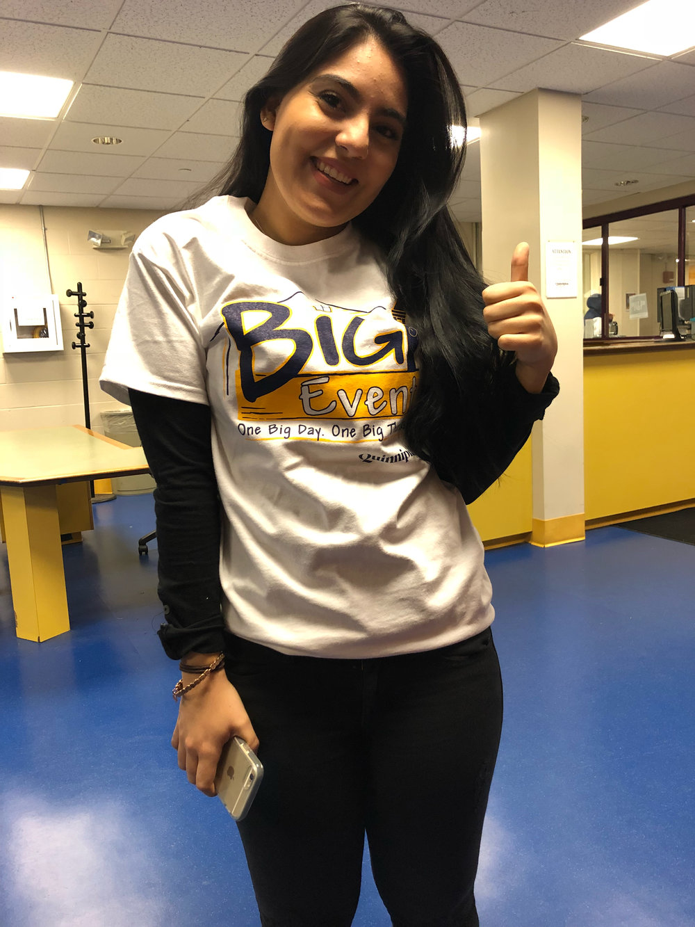 Quinnipiac student Zurama Rodriquez gets ready to head out to volunteer.