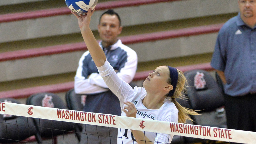 Elizabeth Kloos playing middle hitter during her senior year at Quinnipiac University.