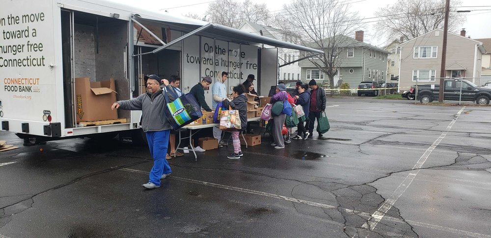 Attendees visit the Connecticut Food Bank truck. (Photo: Ross Lager)