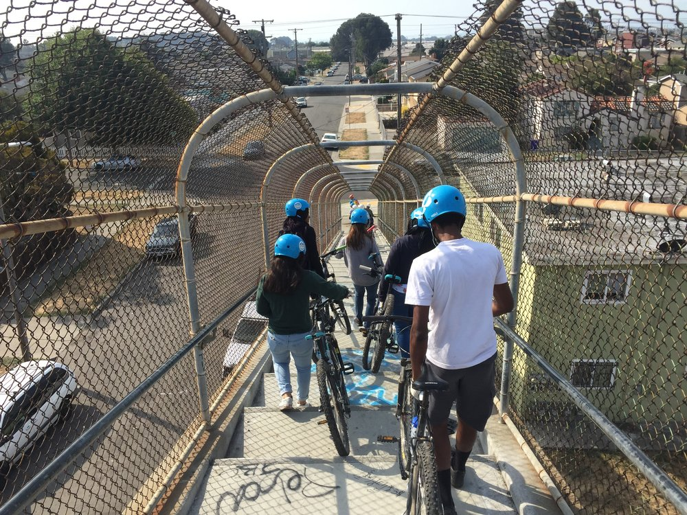 Making out way over the BART tracks and safely down the other side to access the Richmond Greenway
