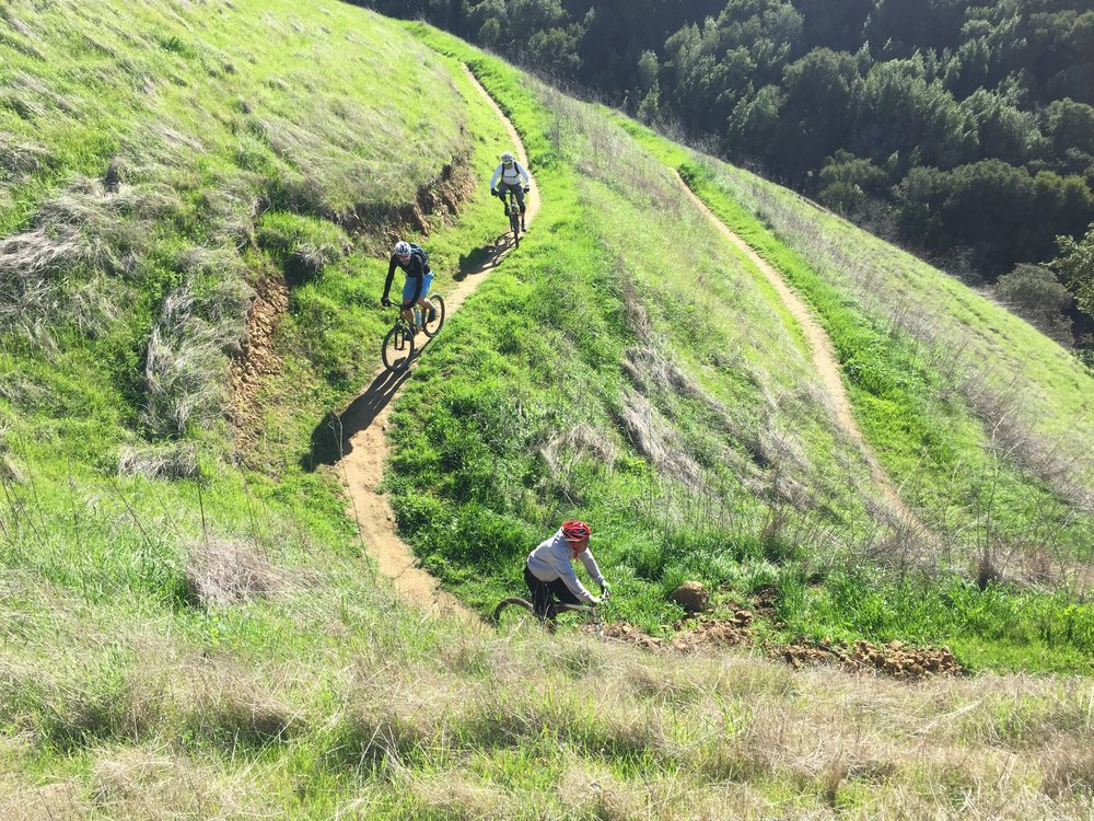 "Donovan leads the team down the flowing ribbon of singletrack known as ""Sugar City"""