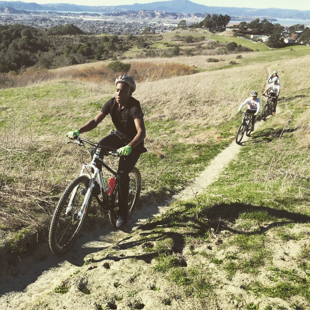 First practice, charging up Wildcat Canyon singletrack with Richmond and Mt. Tam in the background.