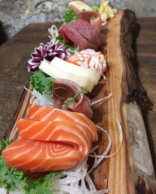 Seasonal garnish on the bar sashimi dinner! Featuring dahlias fresh from the farmers market across the street. #sushiporn #sashimi #foodie #ygkfood #downtownkingston #kingston #eatlocal