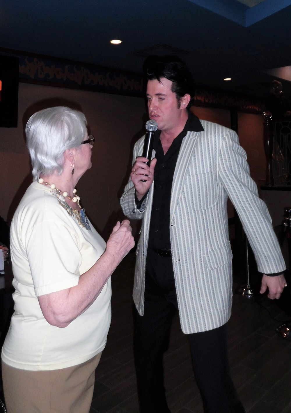 Joan from Stoney Creek dances as  Matt Cage  serenades her during his Flamboro Downs concert.